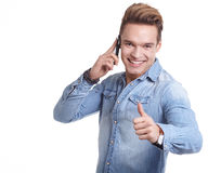 Happy Young Man Using Mobile Phone Isolated On White Background. Happy Young Man Using Mobile Phone Isolated On White stock images