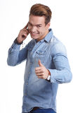Happy Young Man Using Mobile Phone Isolated On White Background. Happy Young Man Using Mobile Phone Isolated On White royalty free stock photos