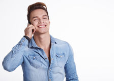 Happy Young Man Using Mobile Phone Isolated On White Background Royalty Free Stock Photography