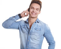Happy Young Man Using Mobile Phone Isolated On White Background Stock Photo