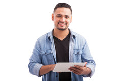 Happy young man using a tablet royalty free stock photography