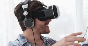 Happy man using virtual reality headset stock video