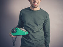 Happy young man with vintage phone Royalty Free Stock Images