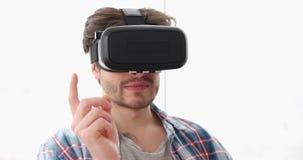 Young man using virtual reality simulator at home stock footage