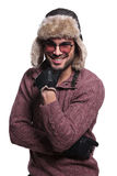 Happy young man in warm sweater and fur hat Royalty Free Stock Photo