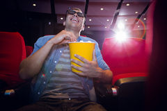 Happy young man watching a 3d film Royalty Free Stock Image