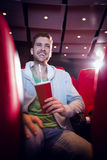 Happy young man watching a film Stock Images