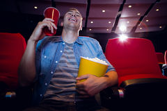 Happy young man watching a film Royalty Free Stock Image