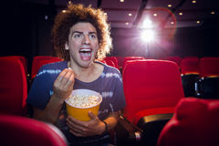 Happy young man watching a film Royalty Free Stock Photo