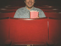 Happy young man watching movie in cinema Royalty Free Stock Image