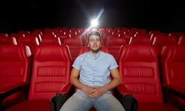 Happy young man watching movie in theater Stock Photo
