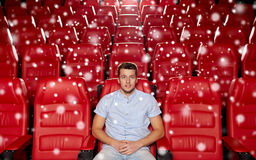 Happy young man watching movie in theater Stock Image