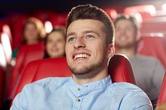 Happy young man watching movie in theater Royalty Free Stock Photo