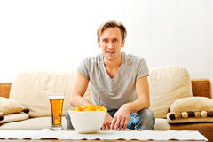 Happy young man watching sports on tv.  Royalty Free Stock Images