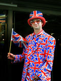 Happy young man waving United Kingdom flag Royalty Free Stock Images