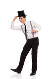 Happy young man wearing top hat. Full length studio shot isolated on white Royalty Free Stock Photos