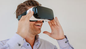 Happy young man wearing virtual reality goggle Stock Photography