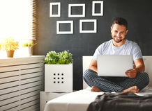 Free Happy Young Man With Laptop In Bed Royalty Free Stock Photos - 99240868