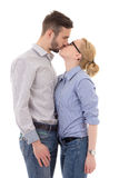 Happy young man and woman kissing isolated on white Royalty Free Stock Photos
