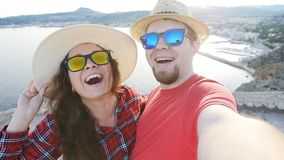 Young couple hiking taking selfie. Happy young man and woman taking self portrait in the mountains. Happy young man and woman taking self portrait with mountain stock video