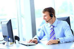Happy young man working at callcenter Royalty Free Stock Photo