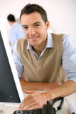 Happy young man working in office Stock Image