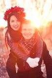 Happy young married couple. Beautiful young pair are smiling and having fun in sunlight Royalty Free Stock Image