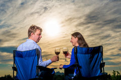 Happy young married couple with a glass of wine. At sunset Stock Photo