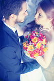Happy young married couple looking at each other Royalty Free Stock Photos