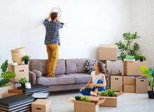 Happy young married couple moves to new apartment stock image