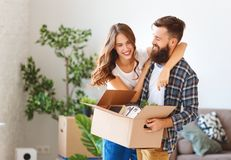 Happy young married couple moves to new apartment stock photos