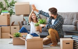 Happy young married couple moves to new apartment royalty free stock photography