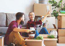 Happy young married couple moves to new apartment royalty free stock photo