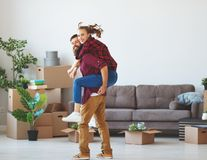 Happy young married couple moves to new apartment stock photography