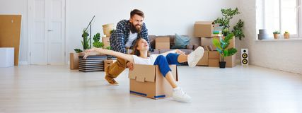 Happy young married couple moves to new apartment stock images