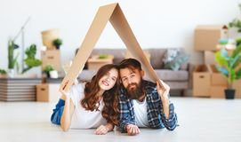 Happy young married couple moves to new apartment royalty free stock photos