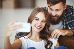 Happy young married couple photographed, makes selfie in new apa Stock Photography