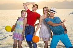 Happy Young Mates at the Beach on Sunset Royalty Free Stock Images
