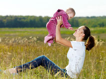 Happy young mather play with smiling baby Royalty Free Stock Photo