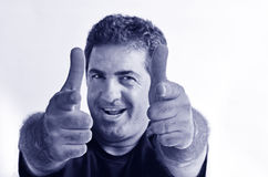 Happy young mature man showing thumbs up Royalty Free Stock Photo
