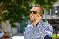 Happy young men calling by phone Stock Image