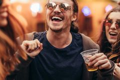 Man with friends dancing at music festival Royalty Free Stock Image