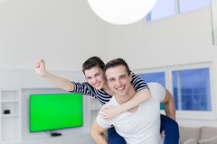 Handsome man piggybacking his girlfriend royalty free stock photography
