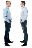 Happy young men standing together Stock Photo