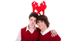 Happy young men wearing reindeer horns Royalty Free Stock Image
