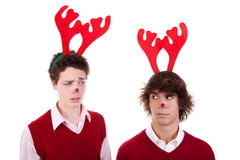 Happy young men wearing reindeer horns, admired. On white, studio shot royalty free stock photos