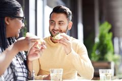 Eating and talking royalty free stock photos