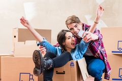 Happy young man and woman making a selfie after moving in into a stock images