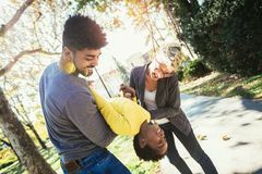 Happy young mixed race couple spending time with their daughter. Having fun royalty free stock photography
