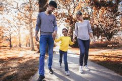 Young mixed race couple spending time with their daughter having fun. Happy young mixed race couple spending time with their daughter having fun stock photography